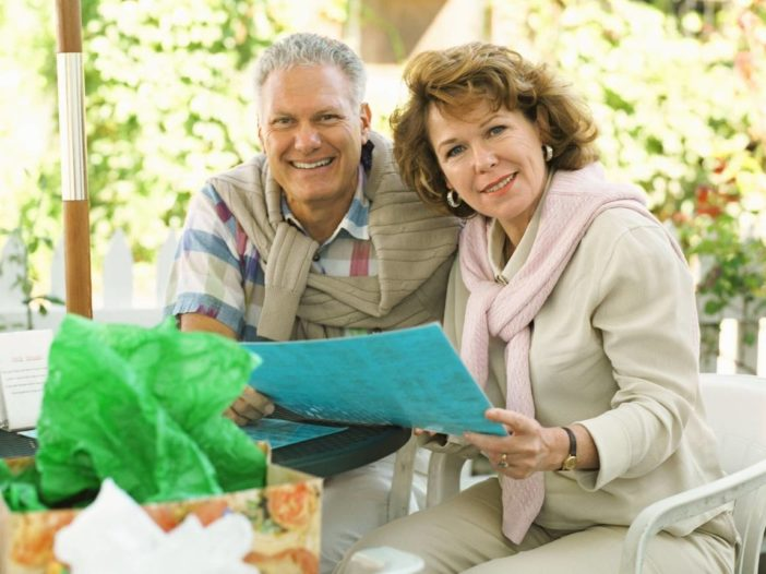 A couple at home using a Reverse Mortgage