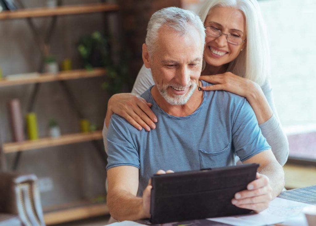 Senior couple learning about reverse mortgages