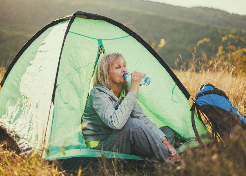 A senior lady camping