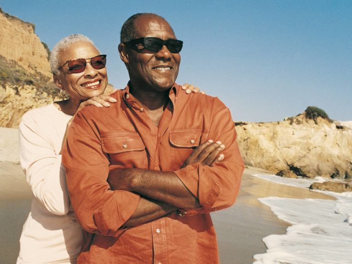Retired Seniors Traveling Frugally to the beach