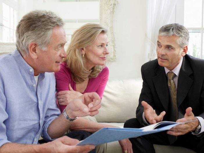 Senior Couple planning for retirement with a Retirement Plan Advisor