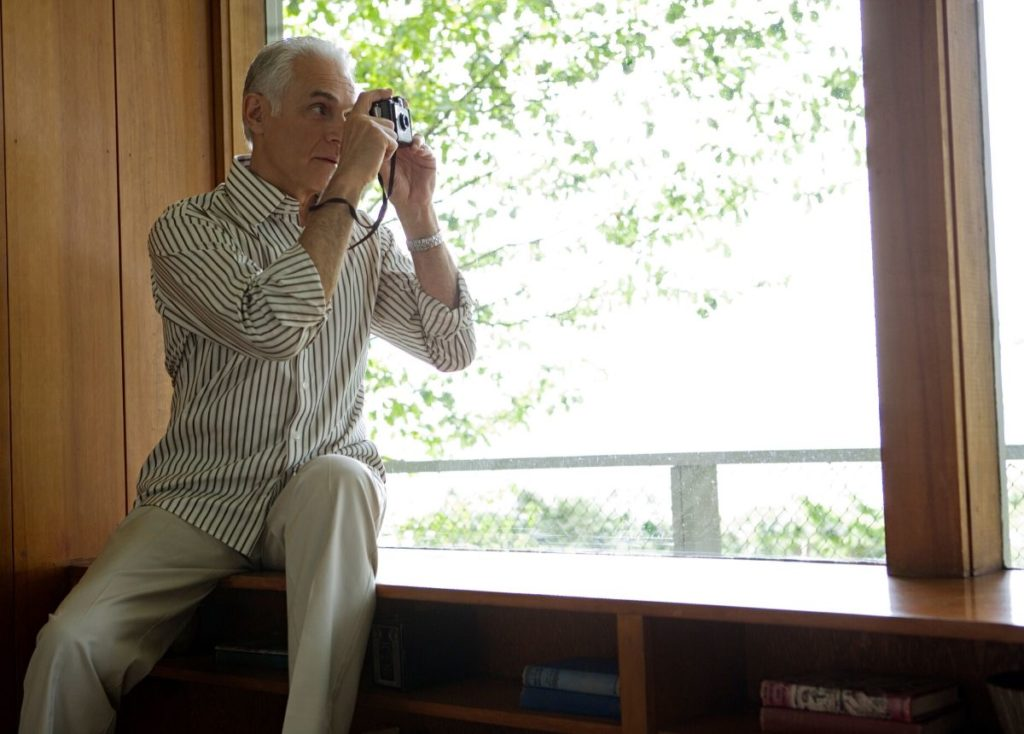 retiree taking photos at home
