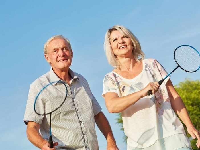 senior citizens playing games at home