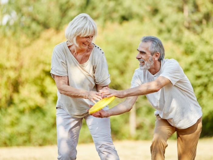 senior citizens playing outdoors